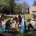 children planting garden