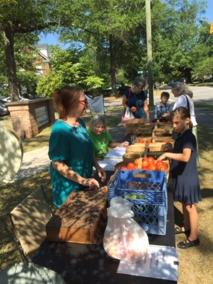 Buying produce at our Seeds of Hope stand.
