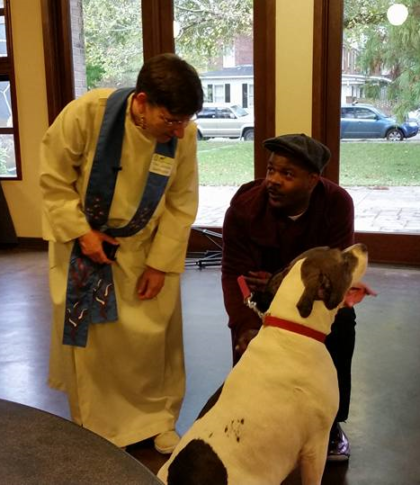 Rev. Barrington blesses dog