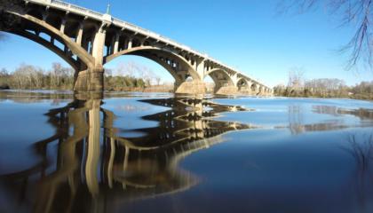 Bridge over reflecting in water