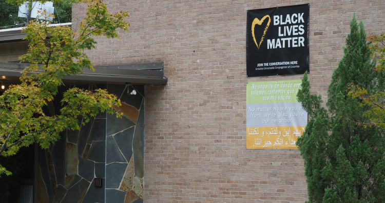 Banners outsite the church entrance of Black Lives Matter and all are welcome