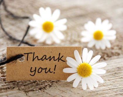 Daisys and Thank You sign