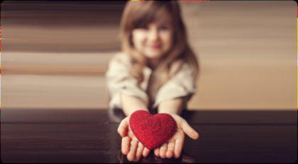 Girl holding heart
