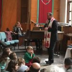Rev. Zsolt speaking to children