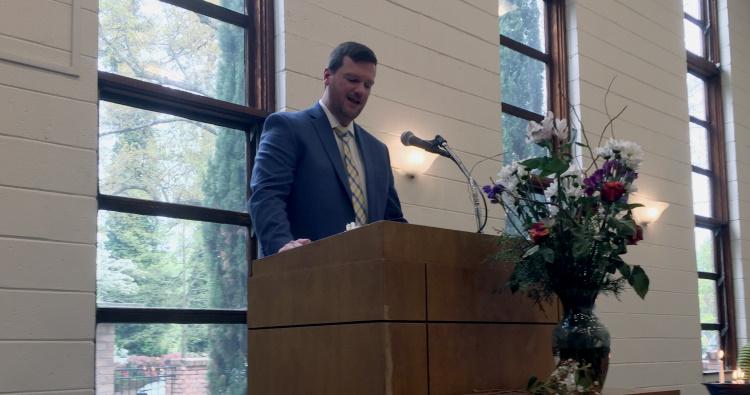 Rev. Stephen Robinson speaking to congregation.