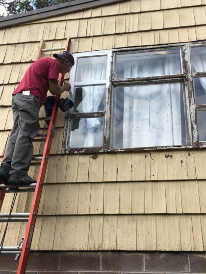 Phil Turner paints window
