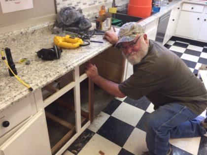 JP Flood preps for dishwasher installation