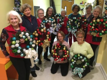Group displayig finished wreaths