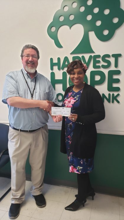 Scott Sargent gives check to Harvest Hope